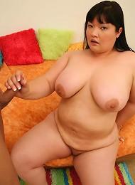 Large Asian babe enjoying a rock hard dick