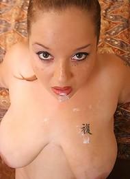Slutty hog in black lace having her massive tits cumsprayed