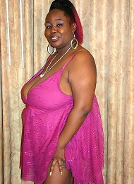 Ebony BBW model flaunts her big tits and taking a big black dick in her fat covered twat