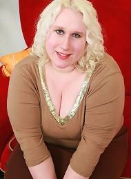 Huge blonde bbw Tina pleasures a big fat cock by cramming it down her deep throat