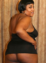 Horny ebony BBW Sasha showing off her huge belly while humping on top of a big black cock