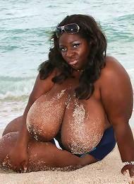 Mega busty Simone Fox at the beach