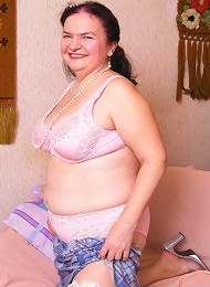 Granny plump stripping naked