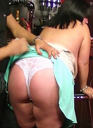 Chunky brunette barmaid with a giant rack gets it on with her customer right in the bar