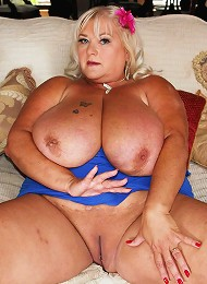 This sexy southern sluts name is Shugar. Shes got cleevage so long and deep even the biggest cock would be lost in between her m