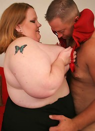 Big titted plumper stuffing her hungry mouth with huge cock